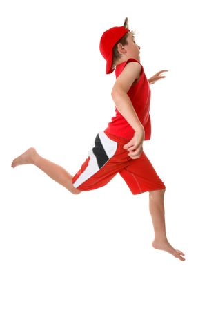 boy barefoot: A boy running or sprinting with large open strides in a hurry  or just energetic, Some motion in  fingers. Stock Photo
