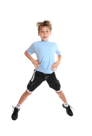 A boy doing fitness exercises on a white background.