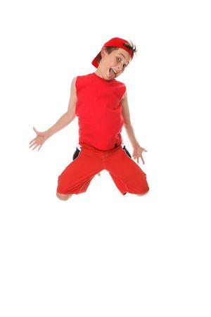 poking: Larrikin boy jumping and poking out tongue. Stock Photo