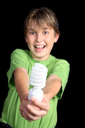 t bulb: A boy wearing a green t-shirt holding out a green energy efficient light bulb Stock Photo