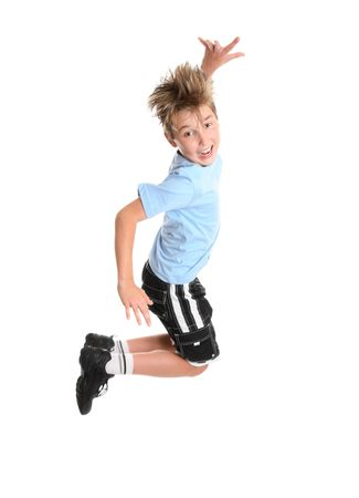 children jumping: Active, energetic and happy go lucky boy leaping and smiling.  fitness or concept Stock Photo