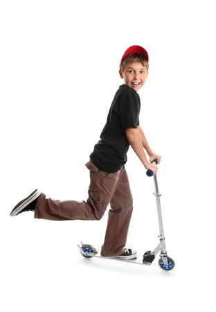 Happy child riding on a toy scooter photo