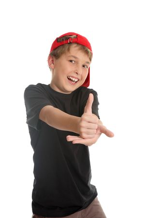 consent: A boy giving the thumbs up hand sign, (focus to hand) a popular western  gesture of approval, consent to go ahead, praise or victory.  However in some middle eastern cultures this gesture translates to a foul insult.