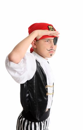 plunder: A boy dressed as pirate on the look out searching for treasure or other merchant ships to hijack and plunder Stock Photo