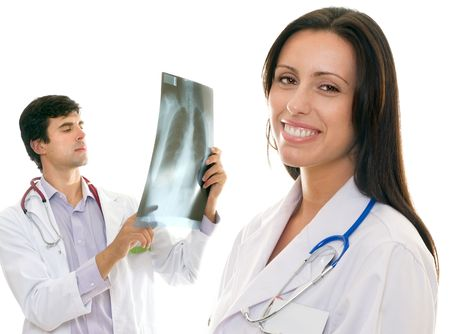 Smiling female nurse or doctor and a male doctor holding up an x-ray photo