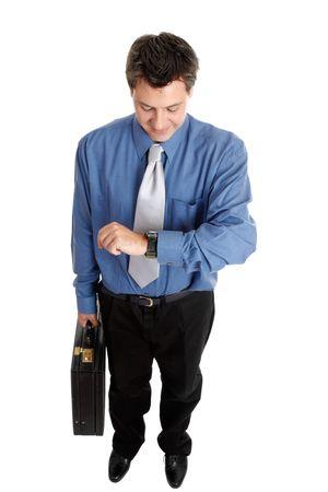 Businessman holding a briefcase checks the time Stock Photo - 2521185