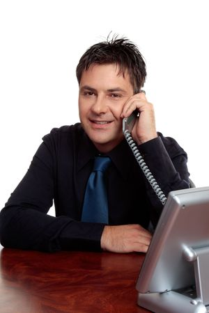 Friendly businessman, salesman or consultant taking a telephone call. photo