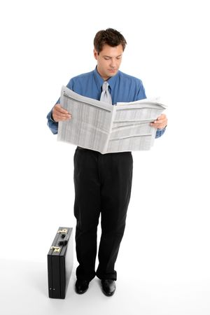 A businessman reads the finance newspaper while waiting for bus, train, taxi.  Newsprint has been blurred. photo