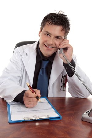 oncologist: Cheerful smiling doctor taking a telephone call Stock Photo