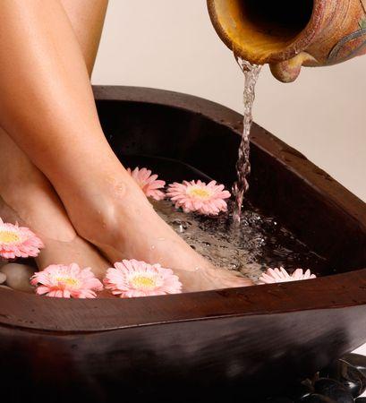 Feet enjoy a relaxing aromatherapy foot spa Stock Photo