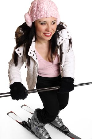 comfy: Active female in winter ski  clothing having fun on some skis
