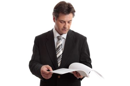dossier: Busienssman reading a report or other document.