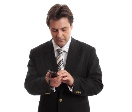 flip phone: A businessman makes a call from a mobile phone.