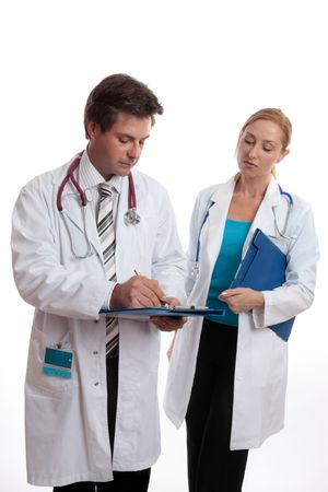 Two doctors discuss a patients medical ailment or treatment. photo