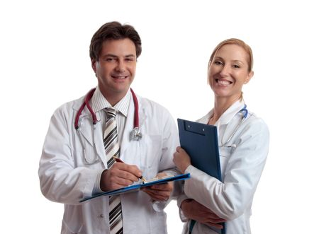 nursing staff: Smiling healthcare professionals holding folders of patient or medical  information.  Focus to male doctor. Stock Photo