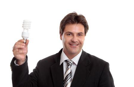 Businessman holding up an eco energy efficient light globe. photo