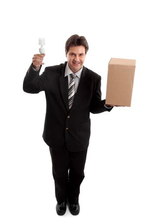 Think outside the box...  A business man balancing a box in one hand and holding an energy efficient light bulb in the other.     eg  ideas, lateral thinking, different perspective, unconventional,  eco  energy, innovation, environment related issues or c photo