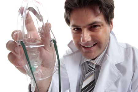 administer: Male doctor, anesthetist or other healthcare professional holding a mask to administer oxygen or other drug. Stock Photo