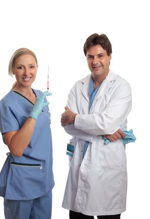 casually: A male surgeon and female scrub nurse in uniform standing casually together. Stock Photo