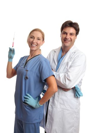 surgical needle: Smiling healthcare staff, male surgeon or doctor and female scrub nurse standing together. Stock Photo