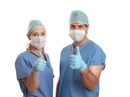 gynaecologist: Two surgeons give the thumbs up  eg: success, approval, quality Stock Photo