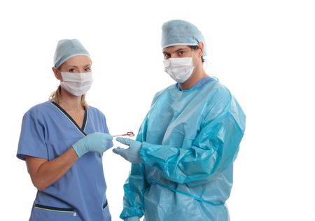 surgical scrubs: Hospital medical staff dressed  in scrubs uniform using surgical instruments.  Space for copy. Stock Photo