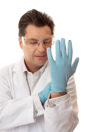 Doctor, surgeon  or laboratory worker putting on disposable safety nitrile examination gloves. photo
