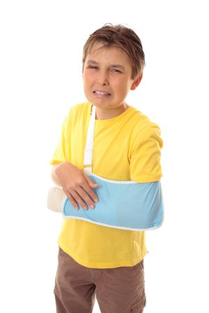 Injured young boy with sore arm in an arm sling photo