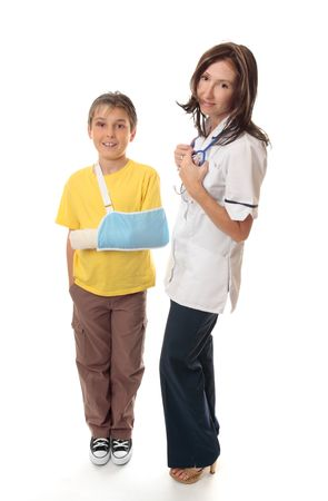 dislocation: Medical officer stands beside an injured young boy. Stock Photo