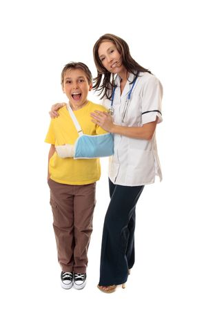 Nurse stands with a happy young  patient after being treated for injuries. photo