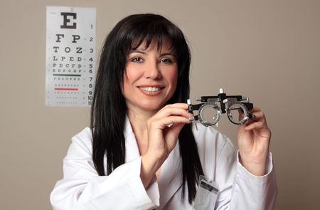 ophthalmic: An eye doctor holding a pair of eye test trial  frames Stock Photo