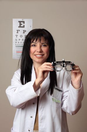 ophthalmic: Optometrist or eye doctor holding trial frames used in vision eyesight checkup
