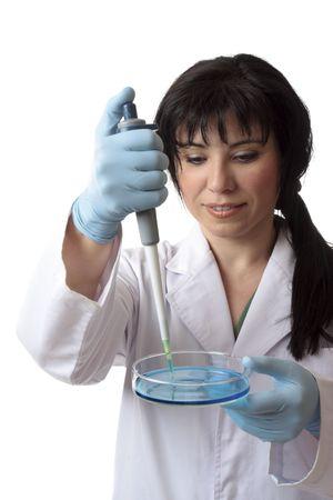Female scientific researcher at work using laboratory equipment photo