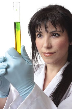 Biologist, in laboratory analyzing test tube research.   Focus to woman. Stock Photo - 3174083