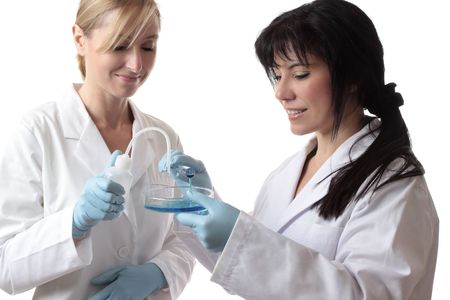 Female scientists at work conducting research photo