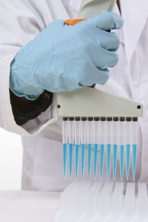 Closeup of a hand holding a digital matrix programmable 850µL multichannel pipetto, used mostly for serological tests, biology and microplate work.  Focus to hand and pipette only. Stock Photo - 3220069