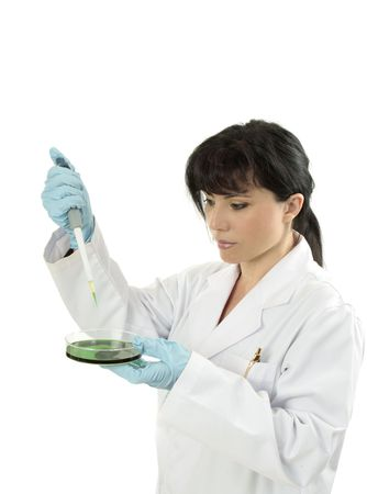 clinician: Clinician wearing lab coat and using a fixed volume pipette.