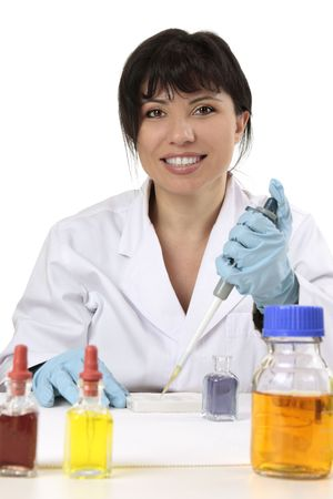 Smiling search scientist using a manual fixed volume pipette and spotting plate.  She is looking straight ahead and smiling cheerfully. photo