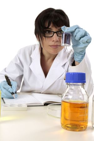 pathologist: Female research scientist sitting at desk with laboratory research and documentation notes.