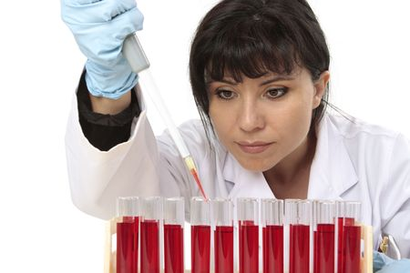 Scientist, pathologist or other lab worker takes a sample from a test tube photo