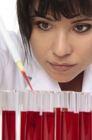 Scientist pathologist,. chemist or other lab worker takes a sample from test tube.   closeup photo