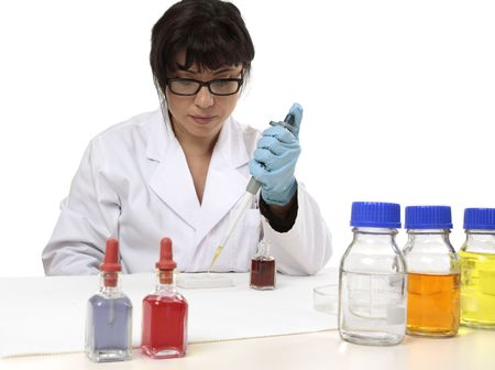 A scientist uses a pipette and spotting plate in laboratory research. photo