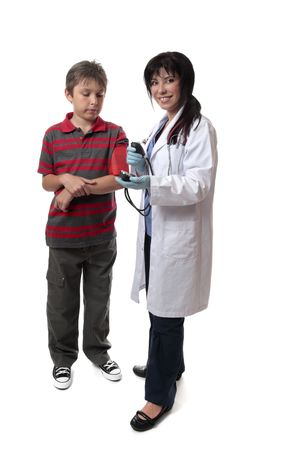 sphygmonanometer: Smiling doctor about to use a blood pressure cuff. Stock Photo