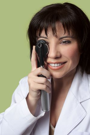 ophthalmic: An eye doctor optometrist using opthalmoscope.
