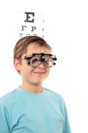 A boy with trial frames during a visit to the eye doctor