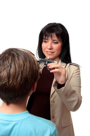 A child getting a vision checkup at the optometrist photo