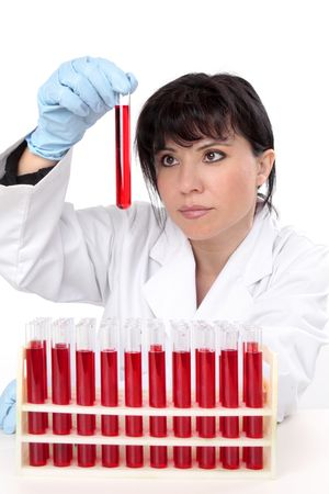 pathologist: A female scientist sitting at desk with rack of  test tubes