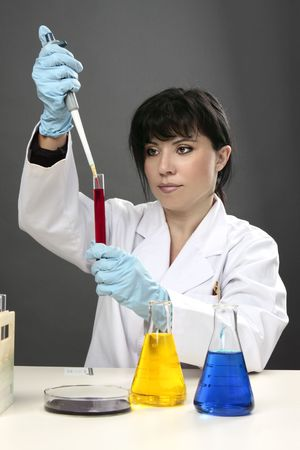 A scientific researcher conducting research, developing a cure or testing for disease or other substances in a laboratory. photo