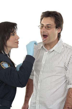 suspect: A crime scene investigator obtains a dna sample from a suspect criminal. Stock Photo
