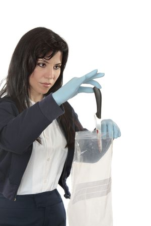 evidence bag: A woman collecting evidence, places a knife in a plastic bag